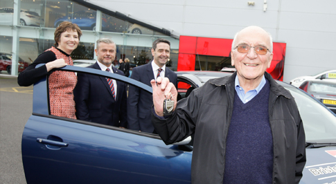 Charity raffle sees great grandfather win car