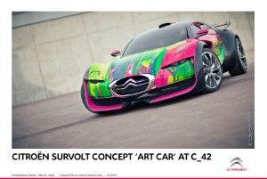 Personalised DS3 and Art Car Survolt on show at French dealership.